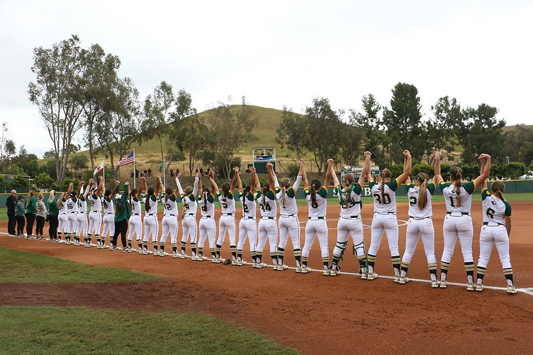 CUI Softball Anthem Hands Raised.JPG