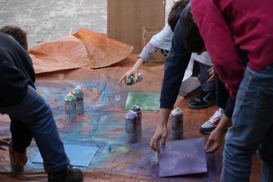 Kids painting boards.JPG