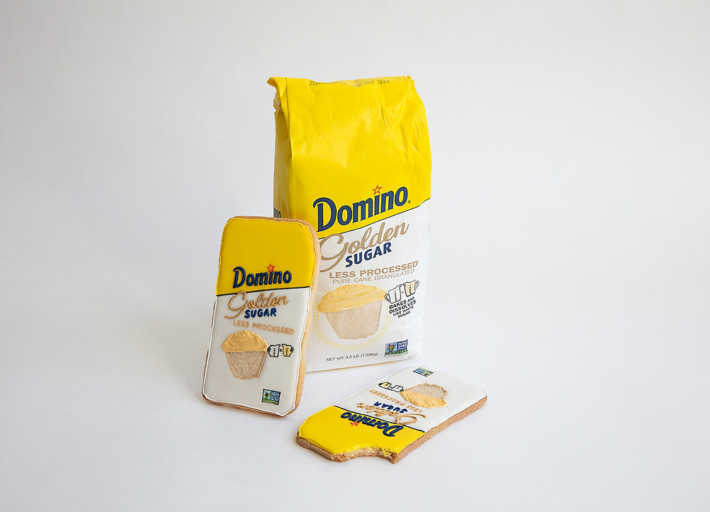 Bag of Domino® Golden Sugar and two Domino® Golden Sugar cookies made by Baked Ideas