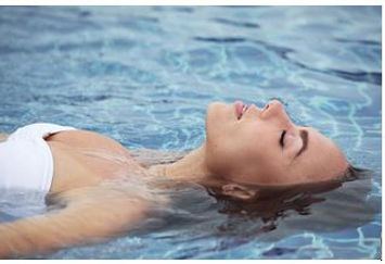 Lady relaxing in water image for Jen Mitchell Bowen therapy Fremantle