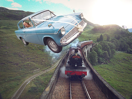 A bride in a flying car flies over the Hogwarts Express