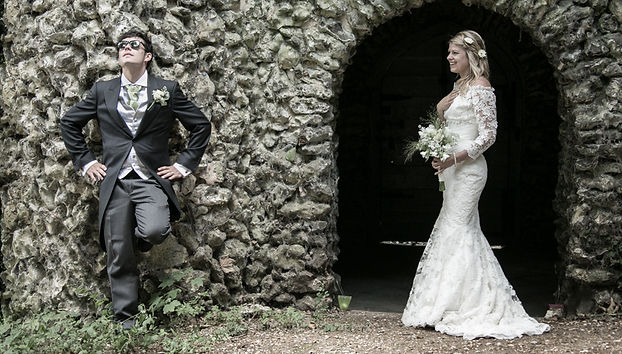 Wedding couple pose by a stone doorway