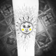 Frederic Agid-tatouage-soleil.jpg