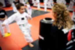 topkick_boykicksmile_taekwondo.jpg