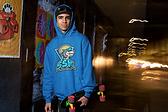 Guy in Blue SSK Hoodie.png