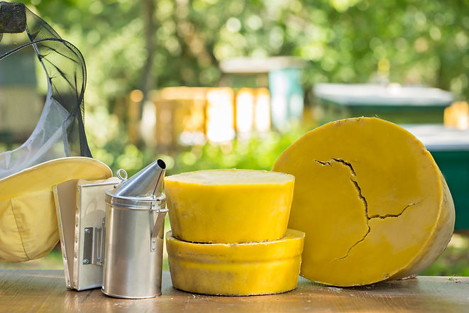 Large round pieces of natural beeswax on