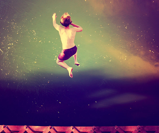 Boy Jumping into Water