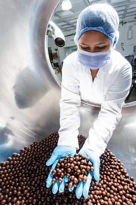 Human operator handling chocolate.png