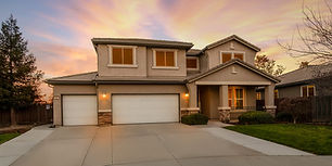 Two story home during golden hour wit pink sky