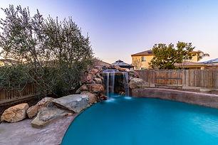 Waterfall feature in backyard pool