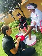 Girls at a birthday pamper party having foot scrubs