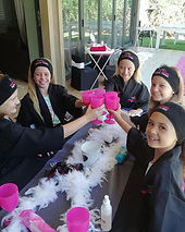 Young ladies raising a kiddies champagne glass at a Pamper party for girls
