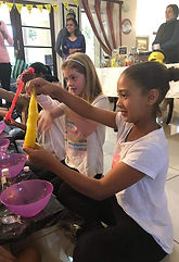 Girls having fun stretching slime at a sugar angel pamper party