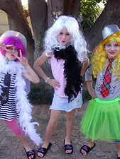 Girls playing dress up at a pamper party