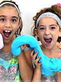 Girls making slime and shouting with joy