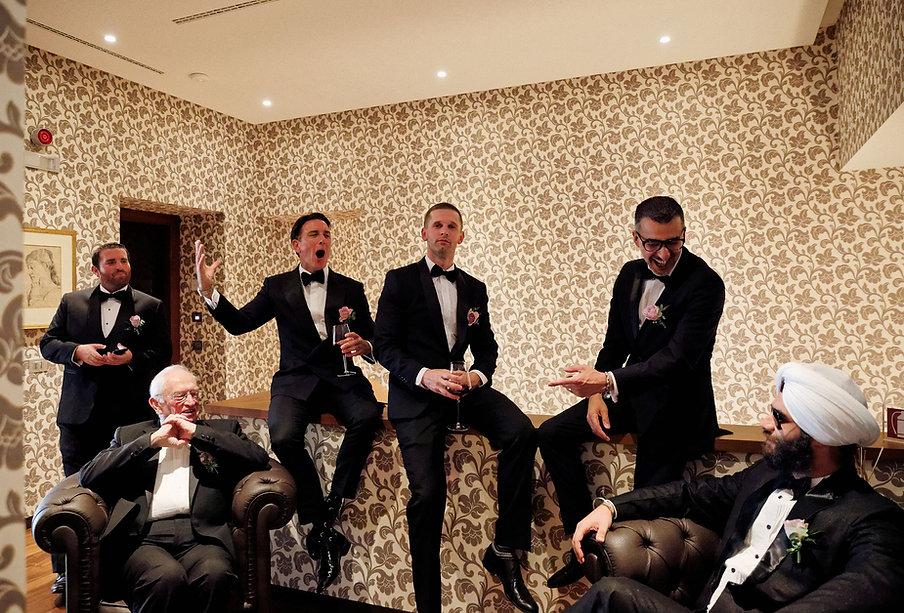 5. groomsmen and best man drinking at Vi