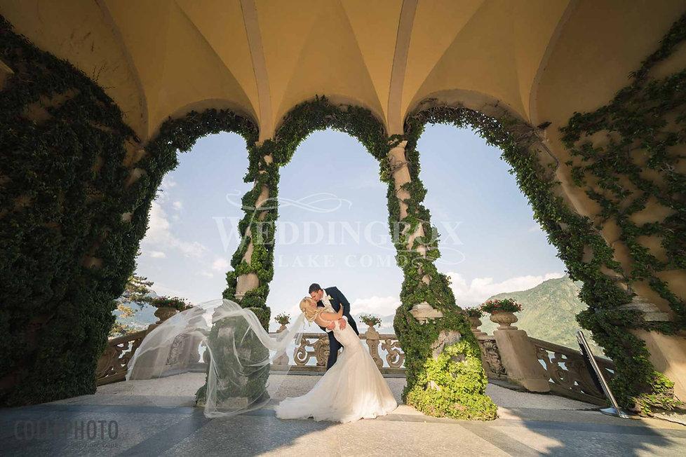 21. Bride and groom pose under the Loggi