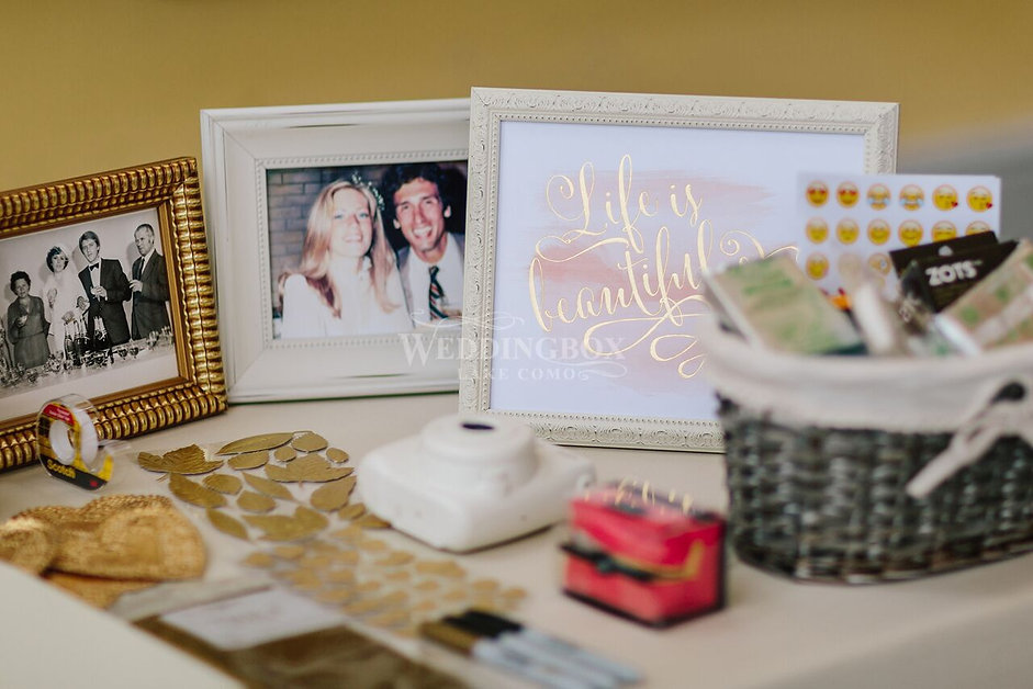 Guest book table with photographs weddin