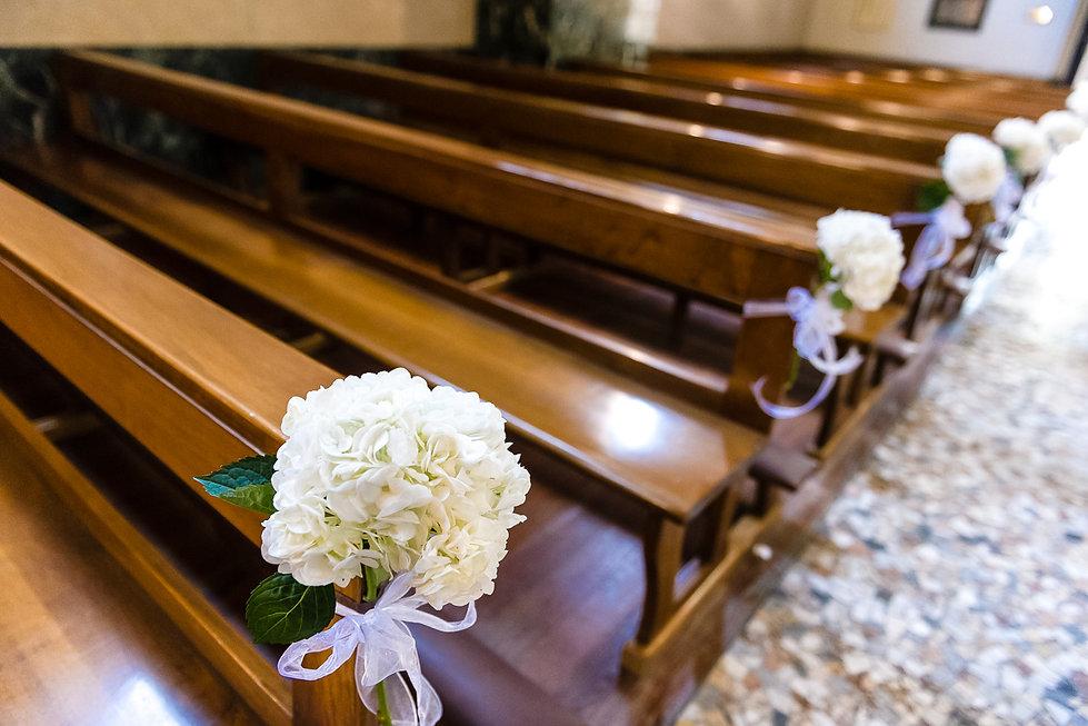 Pew flowers in church.jpg
