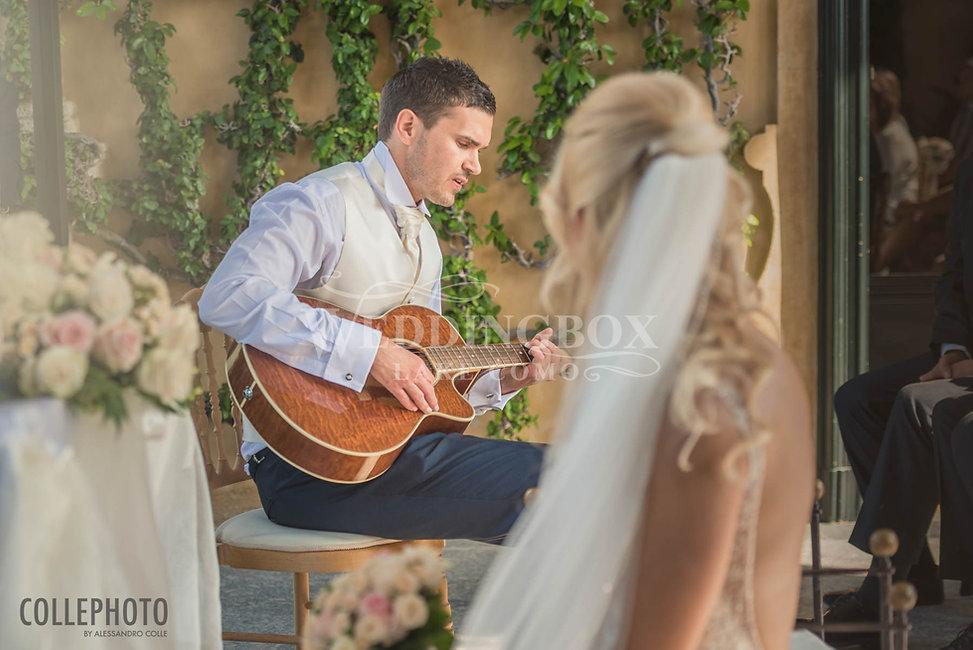 11.  The groom plays guitar at Villa Bal