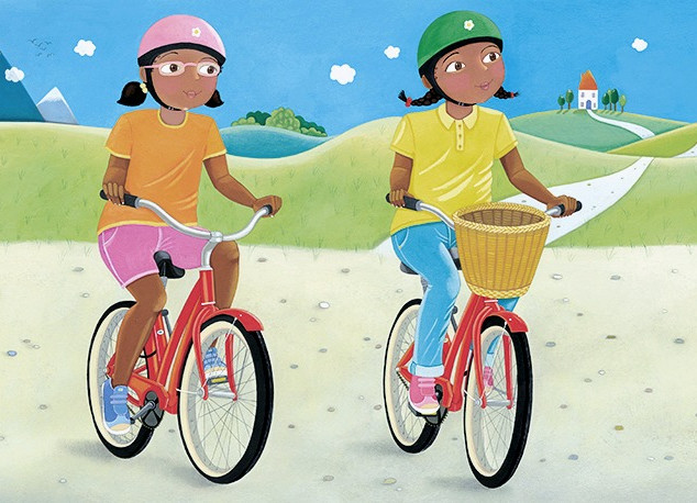 Twins riding their bicycles