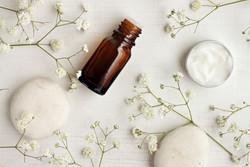 Bottle-Cream-Flowers-Stones.jpg