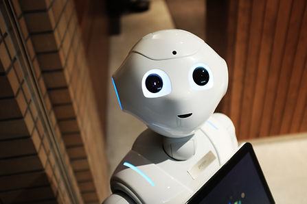 Artificial intelligence robot getting orders from customers at hotel.