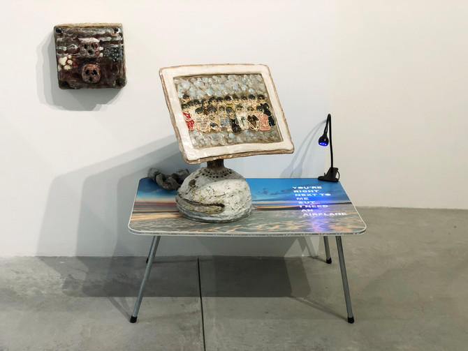 China 2012, You Right Next to Me But I Need A Airplane  ceramics, folding table, blue lights, neon paint. 50x40x60in, 2018