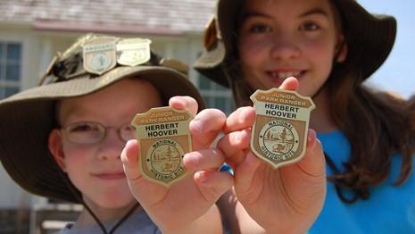children-holding-junior-ranger-badges-military-wild-child