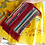 Thumbnail: KOURELOU CLUTCH WITH RED FRINGES