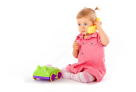 Baby with phone, isolated on a white background.jpg