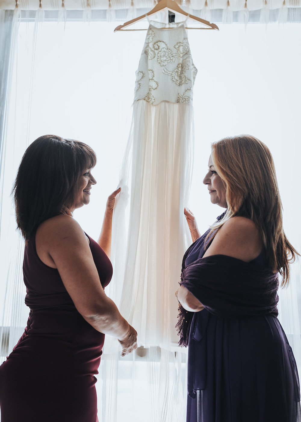 Mother looking at wedding dress