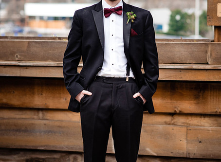 When should I begin looking for tuxes or suits for my upcoming wedding?