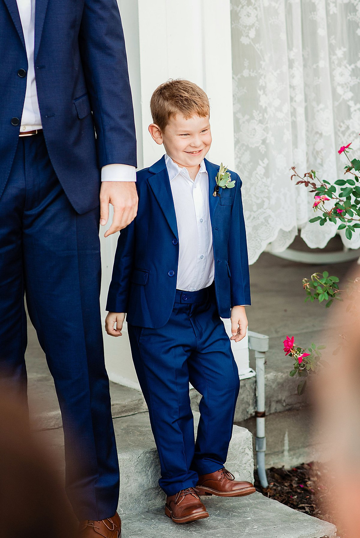 Ring bearer in blue suit