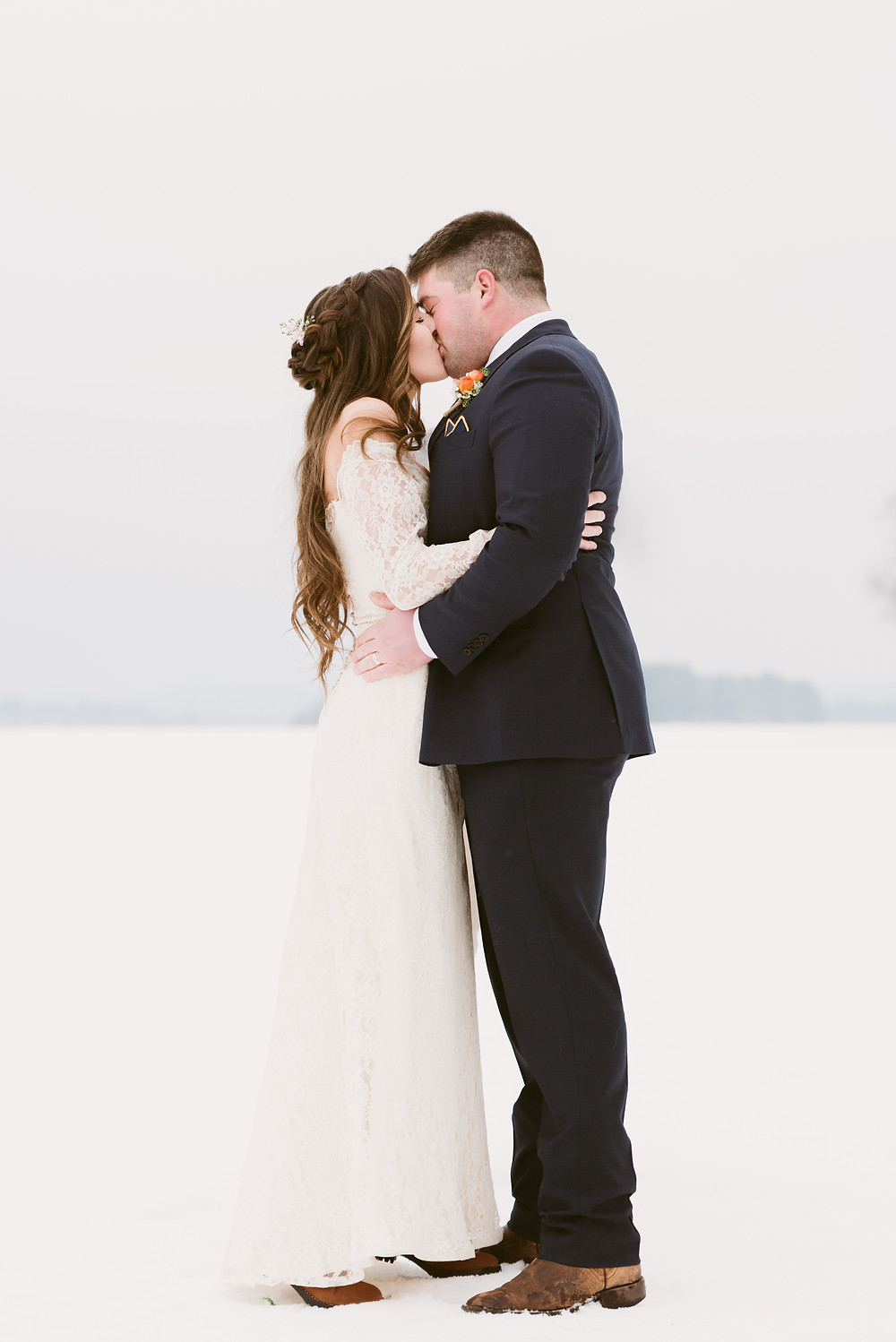 Bride and groom kiss during their wedding ceremony in Schroon Lake