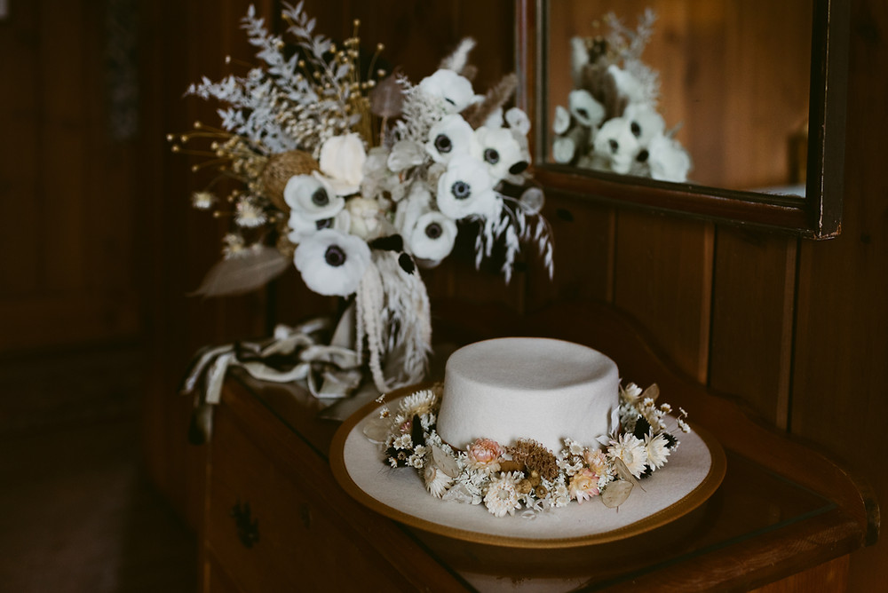 Bride's bolero hat and wedding flowers for Lake Placid elopement