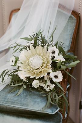 Bride's bouquet featuring massive protea