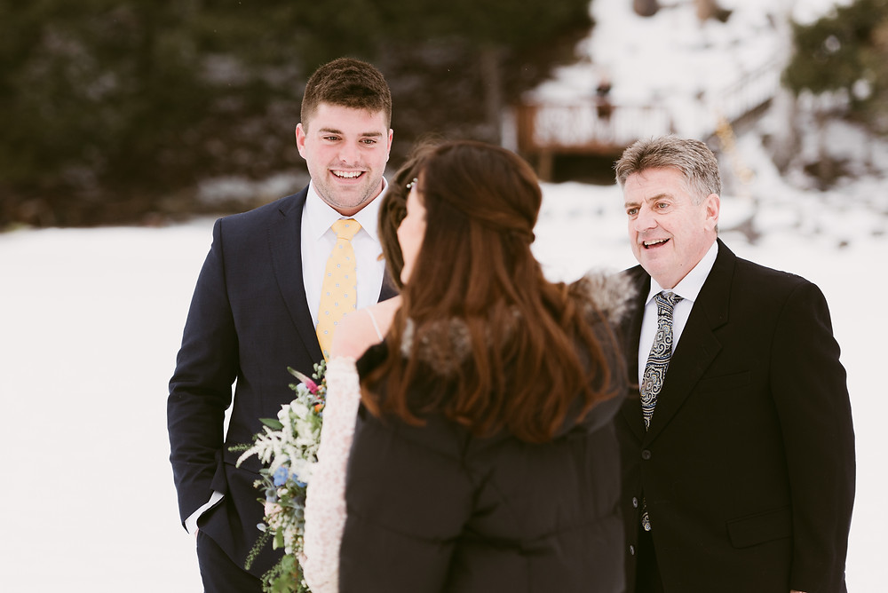 Groom smiles as he sees his bride for the first time