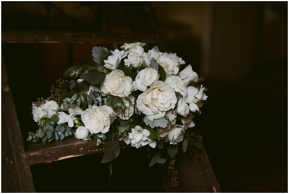 White rose cascading bouquet at outdoor wedding at Worsell Manor