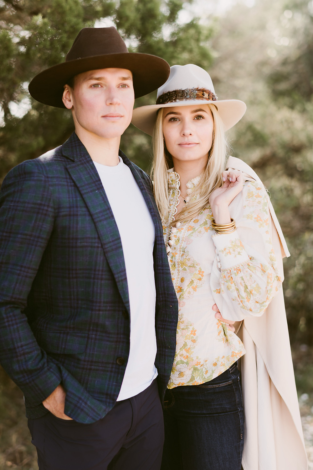 Young stylish couple wearing cowboy hats during their engagement session in Austin, Texas