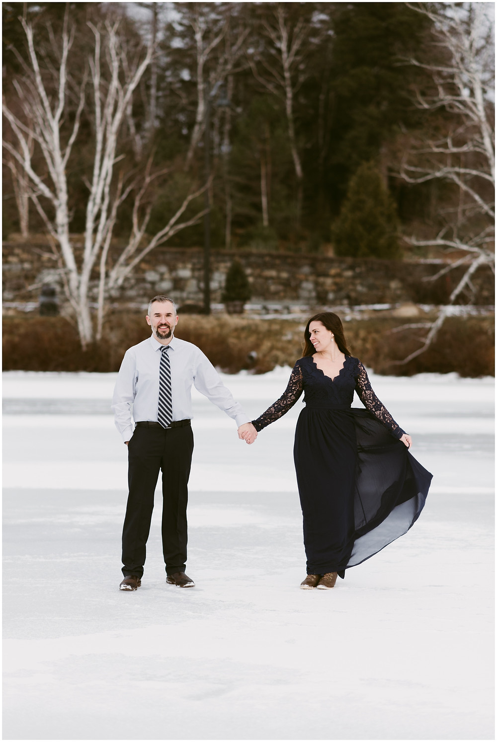 Formal engagement photo on frozen lake in the mountains by Mountainaire Gatherings