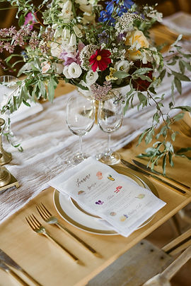 Centerpiece and menu for a wedding at Hayfield in the Catskills
