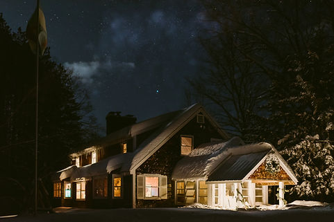Snowy mountain cabin at night in upstate New York