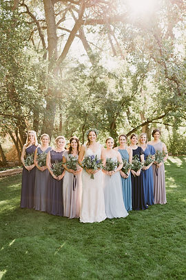 Bride and her bridesmaids pose for a photo in Colorado