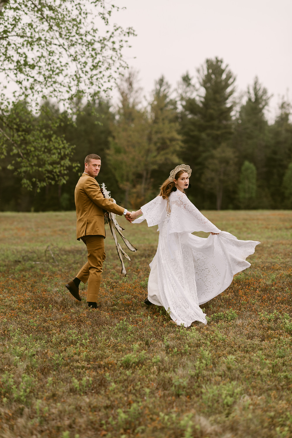 Bride swooshes her Reclamation gown during her upstate New York wedding