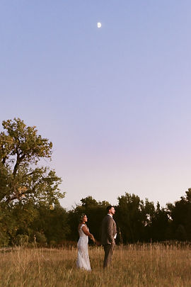 Bride and groom watch the sun go down during their wedding in Colorado