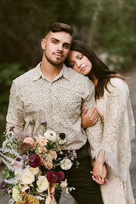 Boho couple poses for their wedding portrait in Keene Valley, NY