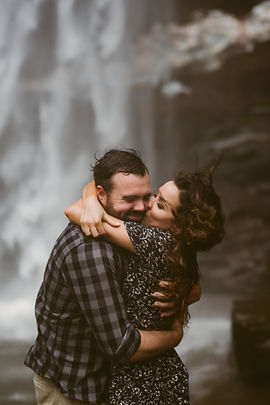 Couple kisses during their engagement session at Kaaterskill Falls