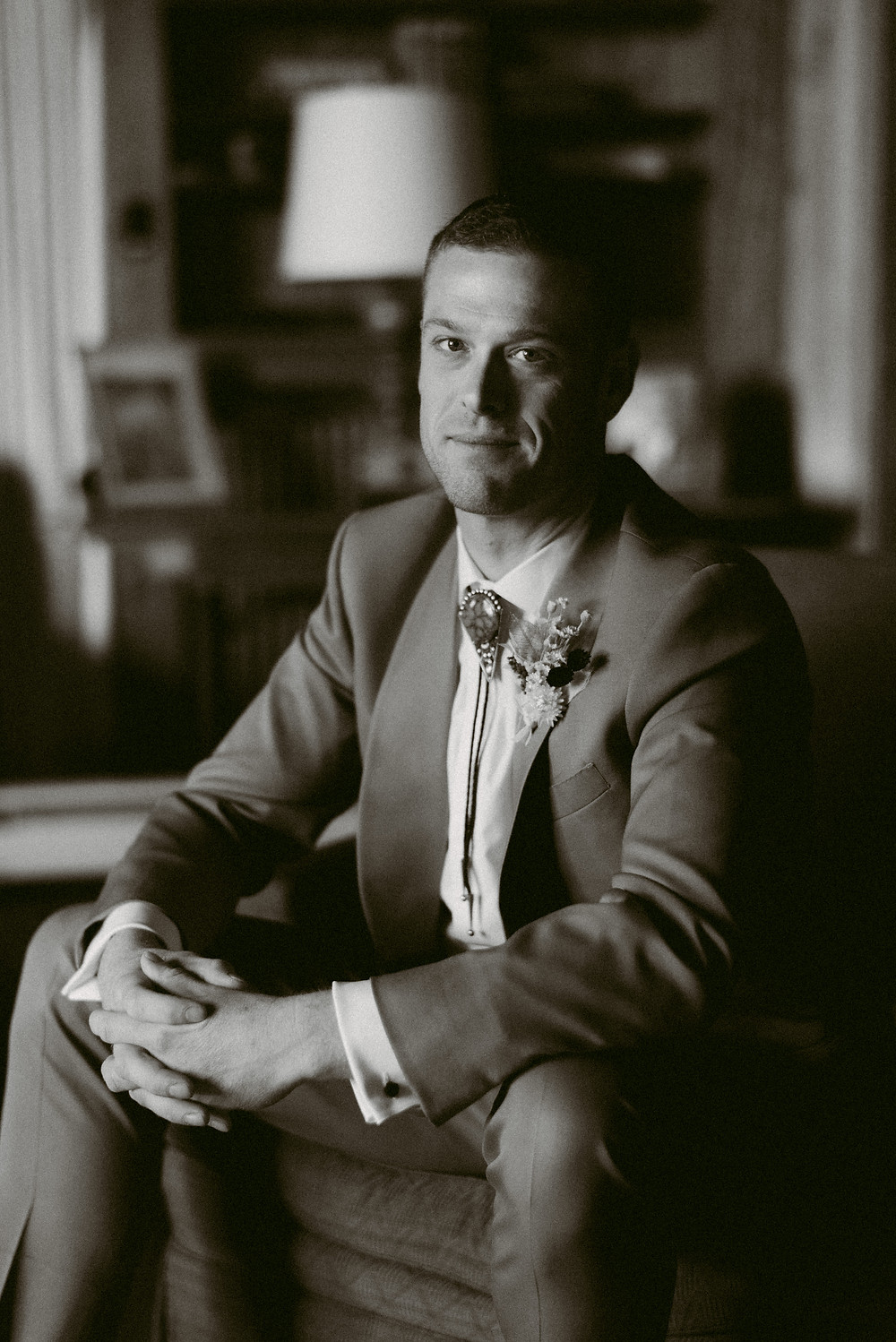 Black and white portrait of a groom smiling on his wedding day in Lake Placid