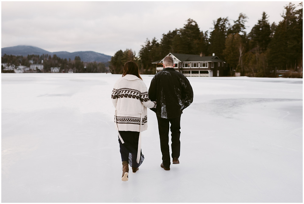 Snowy engagement photos on Mirror Lake in the Adirondacks by Mountainaire Gatherings